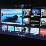 There are five smart screen sections: On TV, Movies & TV Shows, Music, Photos & Videos, Social and Smart TV Apps.