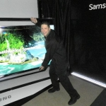 Scott Cohen, National Product Training Manager for Samsung, shows how bigger than life the Samsung Smart TV can be.